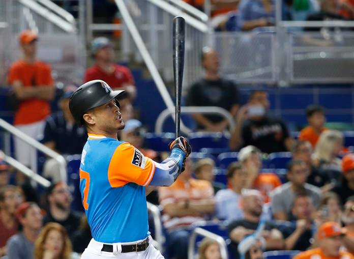 Miami Marlins' Giancarlo Stanton hits a home run against the San Diego Padres, Sunday, Aug. 27, in Miami. (AP Photo/Wilfredo Lee)