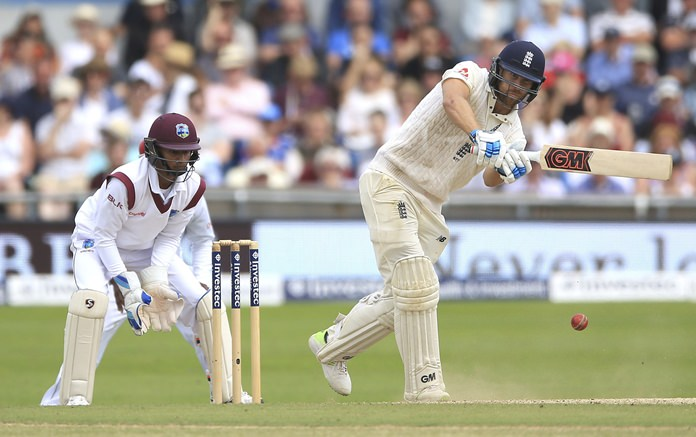 England's Dawid Malan plays a shot against the West Indies during day four of the second test at Headingley cricket ground in Leeds, England, Monday Aug. 28. (Nigel French/PA via AP)