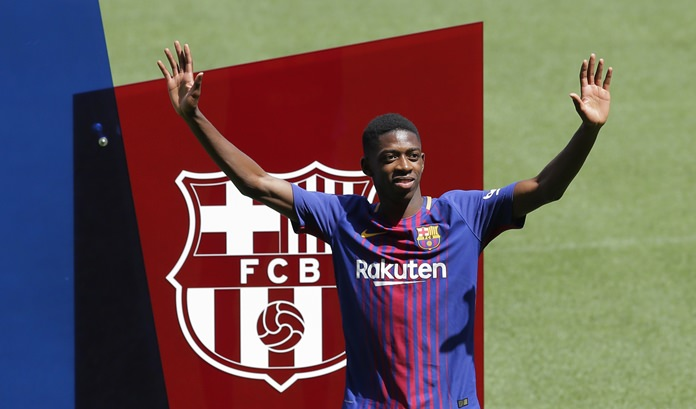 French soccer player Ousmane Dembele gestures during his official presentation at the Camp Nou stadium in Barcelona, Spain, Monday, Aug. 28. (AP Photo/Manu Fernandez)