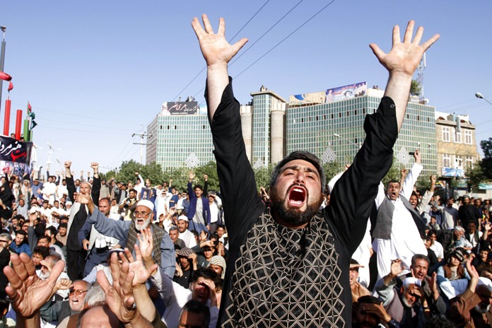Protesters shout slogans during a demonstration in western Herat province of Afghanistan, Wednesday, Aug. 2, 2017. (AP Photo/Hamed Sarfarazi)