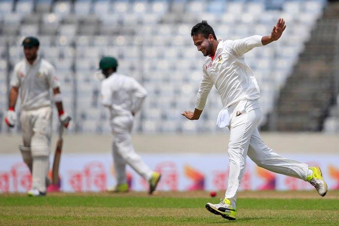 Bangladesh's Sakib Al Hasan, right, celebrates the dismissal of Australia's Glenn Maxwell, left, during the fourth day of the first test in Dhaka, Bangladesh, Wednesday, Aug. 30. (AP Photo/A.M. Ahad)
