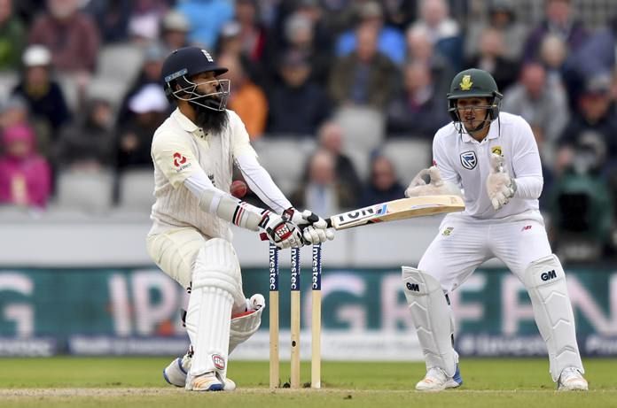 England's Moeen Ali, left, is struck by the ball during day three of the Fourth Test match against South Africa at Emirates Old Trafford in Manchester, England, Sunday Aug. 6. (Anthony Devlin/PA via AP)