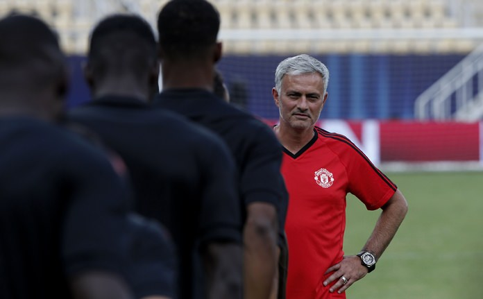 Manchester United's manager Jose Mourinho, right, looks on during a training session at Philip II Arena in Skopje, Macedonia, Monday, Aug. 7, a day ahead of the UEFA Super Cup final match with Real Madrid. (AP Photo/Boris Grdanoski)