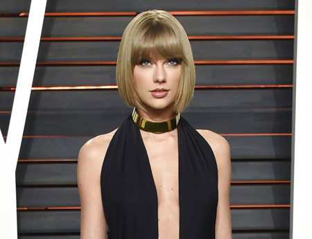 In this Feb. 28, 2016 file photo, singer Taylor Swift attends the Vanity Fair Fair Oscar Party in Beverly Hills, California. (Photo by Evan Agostini/Invision/AP, File)