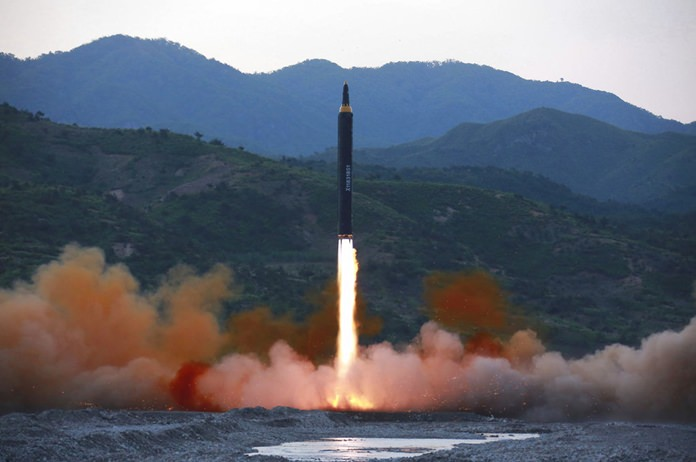 "The ""Hwasong-12,"" a new type of ballistic missile at an undisclosed location in North Korea. (Korean Central News Agency/Korea News Service via AP, File)"