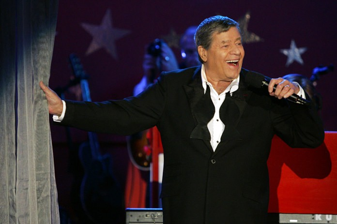 In this Sept. 5, 2005, file photo, longtime host Jerry Lewis performs during the Muscular Dystrophy Association telethon in Beverly Hills, California.(AP Photo/Jae C. Hong, File)
