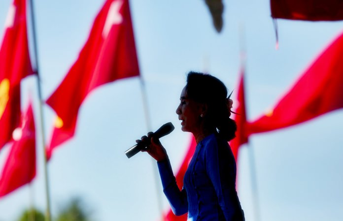 In this Oct. 17, 2015 photo, Aung San Suu Kyi speaks during a campaign rally for her National League for Democracy party in Thandwe, western Rakhine state, Myanmar. (AP Photo/Gemunu Amarasinghe)
