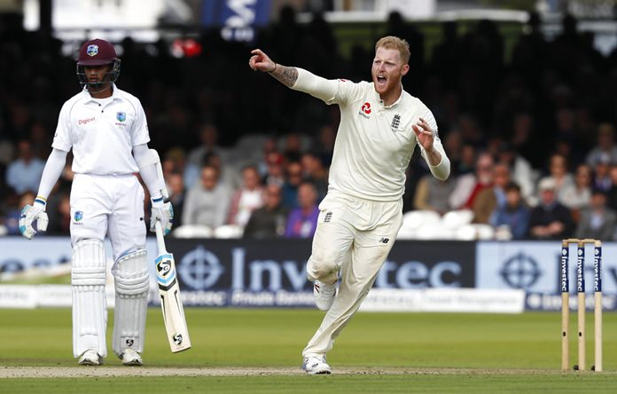 England's Ben Stokes celebrates taking the wicket of West Indies' Roston Chase.(AP Photo/Kirsty Wigglesworth)