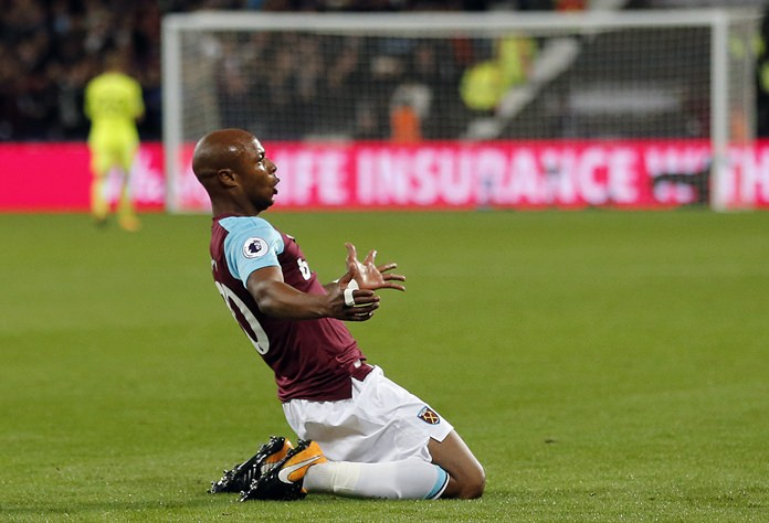 West Ham's Andre Ayew celebrates after scoring his side's second goal during the English Premier League match against Huddersfield Town at London Stadium, Monday, Sept. 11. (AP Photo/Frank Augstein)