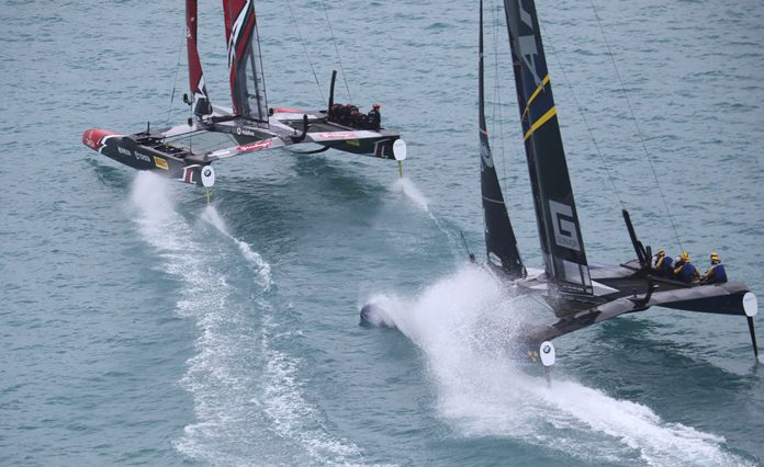 Sweden's Artemis Racing and Emirates Team New Zealand compete in high-tech catamarans during America's Cup challenger semifinals on the Great Sound in Bermuda on Saturday, June 10, 2017. (Gilles Martin-Raget/America's Cup Event Authority via AP)