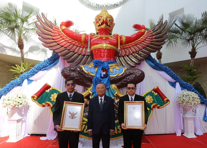 Dr. Prasert Prasarttong-Osoth, chairman of Bangkok Dusit Medical Services PLC, presides over the hoisting to a place of honor on the facility's main building, the Royal Garuda emblem awarded by HM the late King to Bangkok Hospital Pattaya.