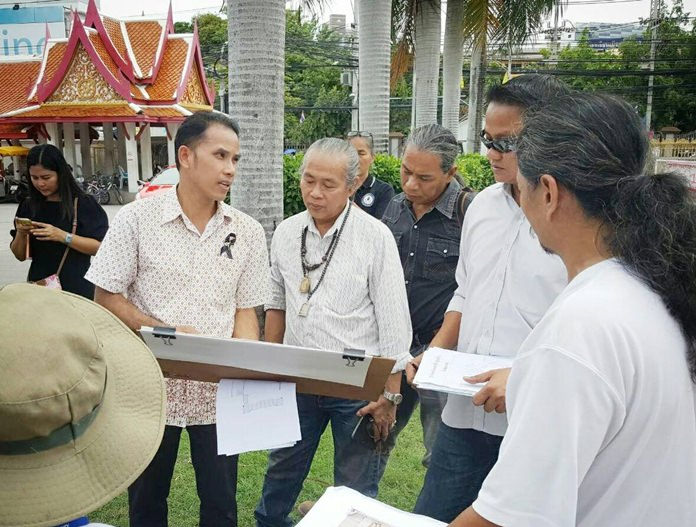 Pattaya Cultural Council President Mana Yaprakham and local officials check Chaimongkol Temple's preparation to host a mirror ceremony for the cremation of King Rama IX in October.