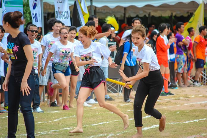 Women athletes pass the baton in the Women's Relay Race.