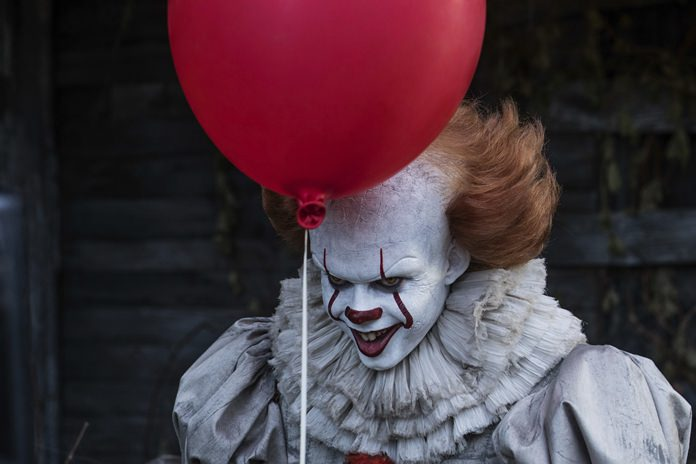 """This image shows Bill Skarsgard in a scene from """"It."""" (Brooke Palmer/Warner Bros. Pictures via AP)"""