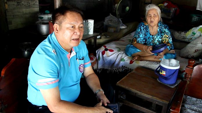 Sawai Chaiboonruang, assistant manager of the PEA's Jomtien office, assured 74-year-old Sek Boonsingh that she and her family would be safe once the PEA gathers funds to repair the damage they caused.
