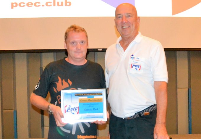 MC Roy Albiston presents Ewan MacGlashan with the PCEC's Certificate of Appreciation for sharing his career as a chef and describing his latest endeavor with the BBQ Prime on 9 restaurant located in the newly named Sanook Park.