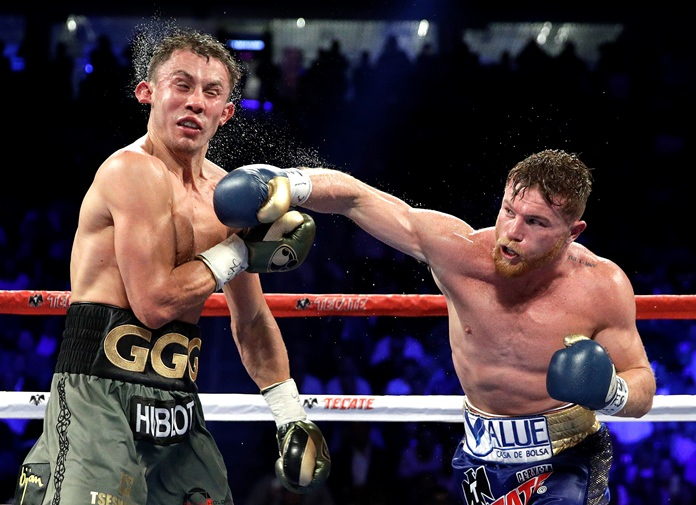 Canelo Alvarez (right) connects with a right to Gennady Golovkin during their middleweight title fight Saturday, Sept. 16, in Las Vegas. (AP Photo/John Locher)