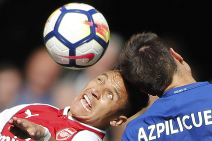 Arsenal's Alexis Sanchez (left) and Chelsea's Cesar Azpilicueta jump to head the ball during their team's English Premier League match at Stamford Bridge stadium in London, Sunday, Sept. 17. (AP Photo/Frank Augstein)