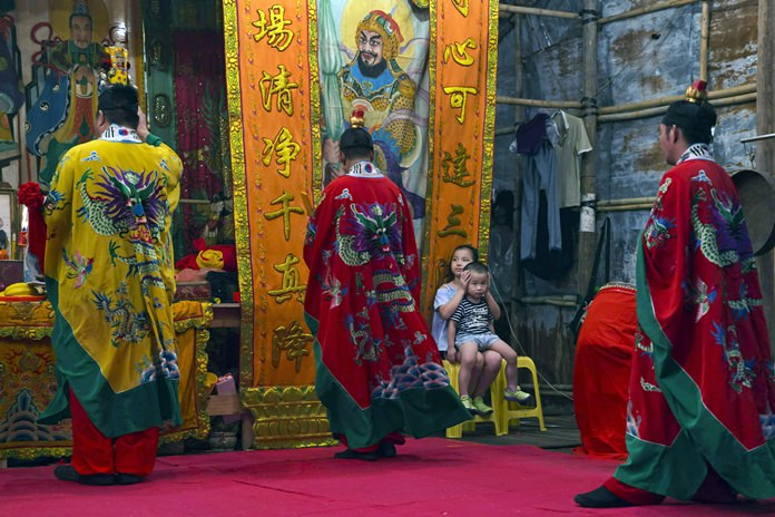 """Taoists attend a service during the """"Hungry Ghost Festival"""" in Hong Kong. (AP Photo/Kin Cheung)"""