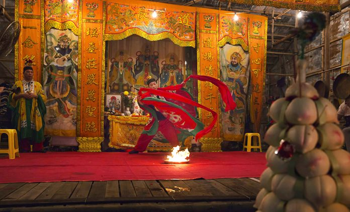 Taoists attend a service at a makeshift theater. (AP Photo/Kin Cheung)