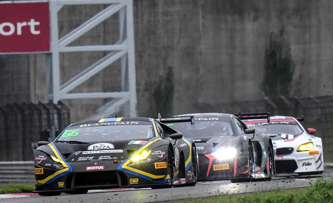 Thai driver Sandy Stuvik (left) leads the Blancpain GT Series Asia Race 1 at the Shanghai F1 Circuit in Shanghai, China, Saturday, Sept. 23.