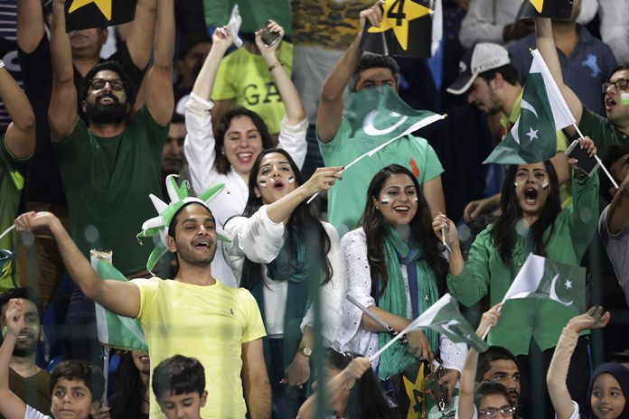 Pakistani cricket fans watch a match between World XI and Pakistan at Gaddafi stadium, in Lahore, Pakistan, Tuesday, Sept. 12. (AP Photo/K.M. Chaudary)