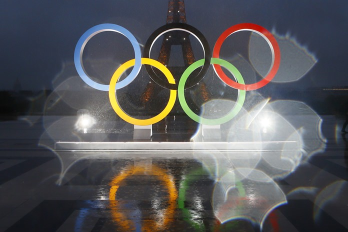 With rain drops on the camera lens, the Olympic rings are shown in Trocadero plaza that overlooks the Eiffel Tower in Paris. The 2024 Olympic Games were awarded to the French capital during a ceremony held in Lima, Peru, Wednesday, Sept. 13. (AP Photo/Francois Mori)