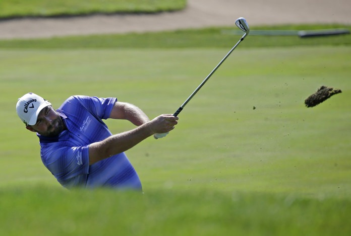 Marc Leishman watches his second shot on the 16th hole.(AP Photo/Nam Y. Huh)