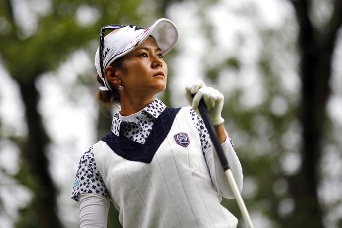 Ai Miyazato of Japan follows her ball after playing on the 10th hole.(AP Photo/Laurent Cipriani)
