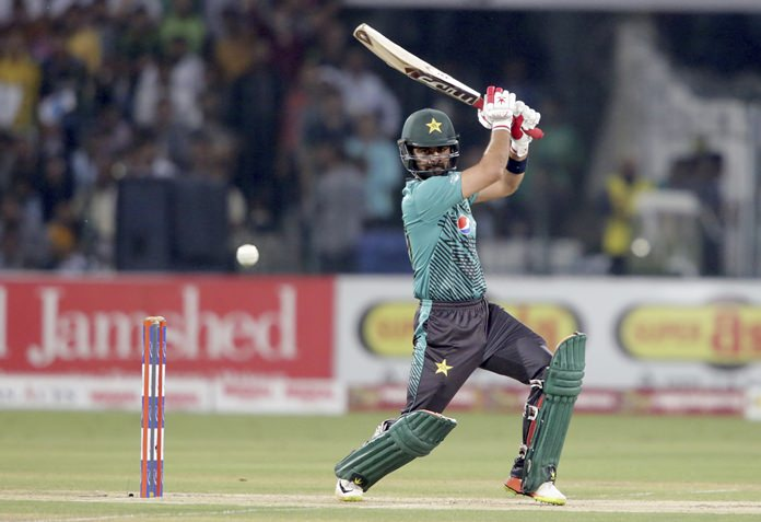 Pakistan's Ahmed Shahzad hits boundary against the World XI team at the Gaddafi stadium in Lahore, Pakistan, Friday, Sept. 15. (AP Photo/K.M. Chaudary)