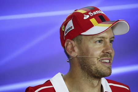 Ferrari driver Sebastian Vettel of Germany speaks during a press conference after the qualifying session for the Singapore Formula One Grand Prix on the Marina Bay City Circuit Singapore, Saturday, Sept. 16. (AP Photo/Yong Teck Lim)