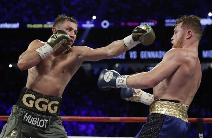 Gennady Golovkin, left, fights Canelo Alvarez during their middleweight title fight Saturday, Sept. 16, in Las Vegas. (AP Photo/John Locher)