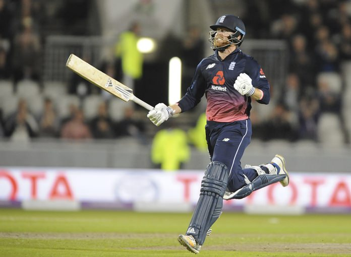 England's Johnny Bairstow celebrates after reaching a century during the first One Day International match between England and West Indies at Old Trafford in Manchester, Tuesday, Sept. 19. (AP Photo/Rui Vieira)