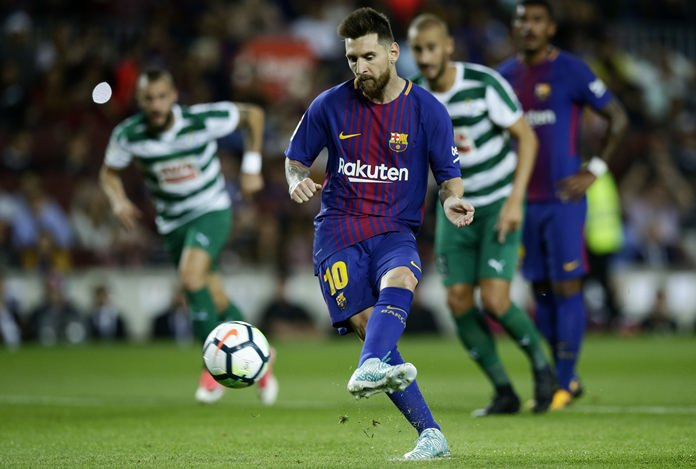 FC Barcelona's Lionel Messi scores a penalty during the Spanish La Liga soccer match against Eibar at the Camp Nou stadium in Barcelona, Tuesday, Sept. 19. (AP Photo/Manu Fernandez)