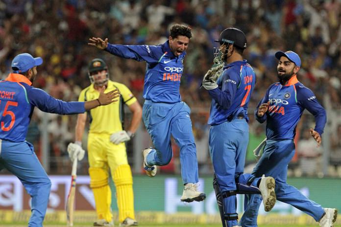 India's Kuldeep Yadav celebrates after taking his third wicket in an over during the second one-day international cricket match against Australia at Eden Gardens in Kolkata, India, Thursday, Sept. 21, 2017. (AP Photo/Bikas Das)