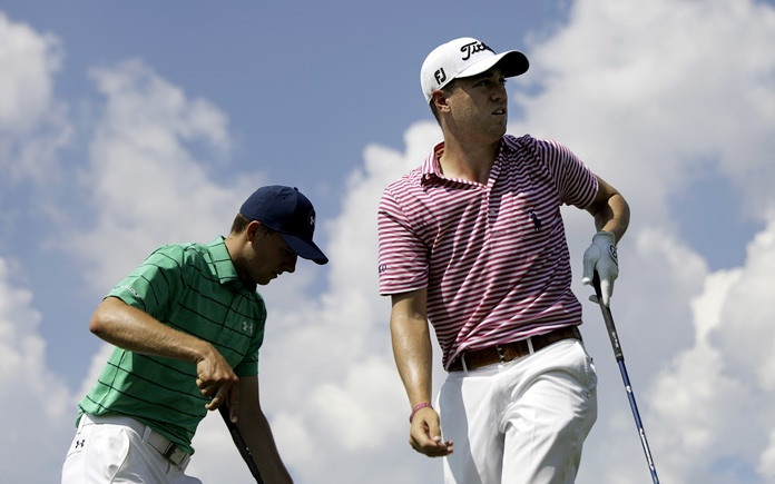 Justin Thomas, right, watches his shot after teeing off on the sixth hole as Jordan Spieth steps up to hit during the second round of the Tour Championship golf tournament at East Lake Golf Club in Atlanta, Friday, Sept. 22. (AP Photo/David Goldman)