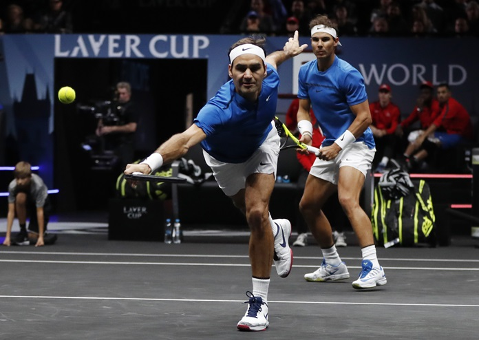 Europe's Rafael Nadal, right, watches teammate Roger Federer, left, return a ball to World's Jack Sock and Sam Querrey during their Laver Cup doubles tennis match in Prague, Czech Republic, Saturday, Sept. 23. (AP Photo/Petr David Josek)