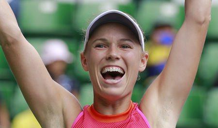 Caroline Wozniacki of Denmark celebrates after beating Anastasia Pavlyuchenkova of Russia at in the final of the Pan Pacific Open tennis tournament in Tokyo, Sunday, Sept. 24. (AP Photo/Shizuo Kambayashi)