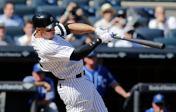 New York Yankees' Aaron Judge hits a two-run homer during the third inning of a baseball game against the Kansas City Royals at Yankee Stadium, Monday, Sept. 25in New York. (AP Photo/Seth Wenig)