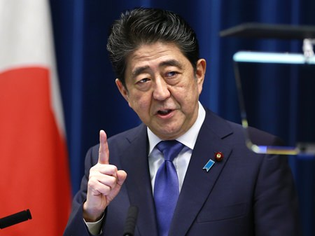 Japan's Prime Minister Shinzo Abe speaks during a press conference at the prime minister's official residence in Tokyo, Monday, Sept. 25. (AP Photo/Shizuo Kambayashi)
