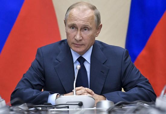 Russian President Vladimir Putin speaks during a meeting at the Novo-Ogaryovo residence outside Moscow, Russia, Wednesday, Sept. 27. (Mikhail Klimentyev/Pool Photo via AP)