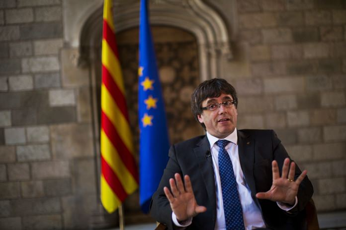 Catalonia's regional president, Carles Puigdemont speaks during an interview with The Associated Press at the Palace of Generalitat or Catalan government headquarters, in Barcelona, Spain, Wednesday, Sept. 27. (AP Photo/Emilio Morenatti)