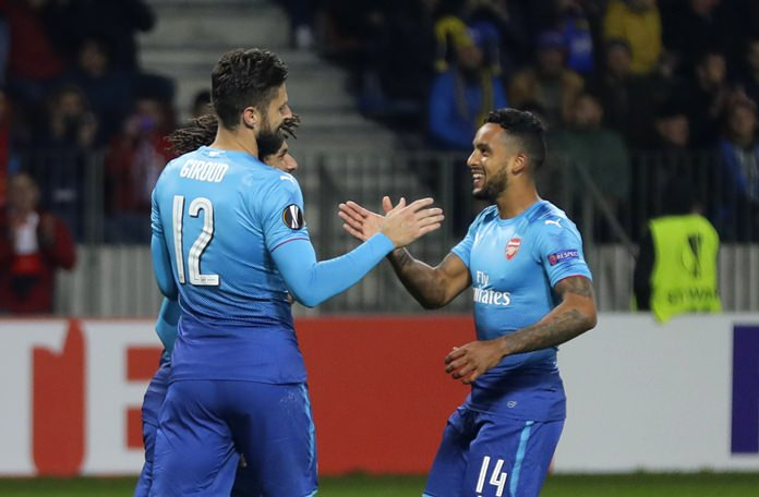 Arsenal's Olivier Giroud, left, celebrates with Theo Walcott after scoring his side's fourth goal during the Europa League group H soccer match between Bate and Arsenal at the Borisov-Arena stadium in Borisov, Belarus, Thursday, Sept. 28. (AP Photo/Sergei Grits)