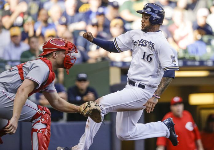 Milwaukee Brewers' Domingo Santana, right, begins his slide to beat the throw to Cincinnati Reds' Stuart Turner, left, during the fourth inning of their baseball game Thursday, Sept. 28, in Milwaukee. (AP Photo/Tom Lynn)