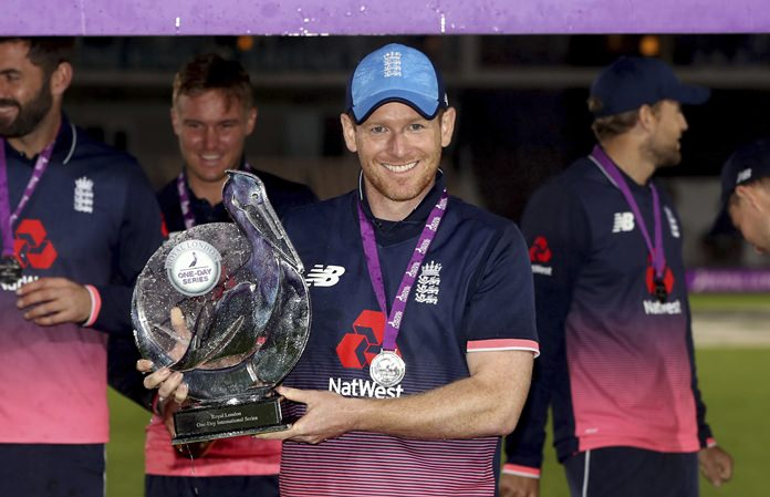 England's Eoin Morgan poses with the trophy after the fifth one day international cricket match between England and the West Indies, at the Ageas Bowl, Southampton, England, Friday Sept. 29. (Simon Cooper/PA via AP)
