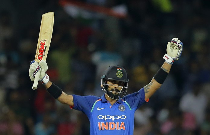 India's captain Virat Kohli raises his bat to celebrate scoring a century during the fifth one-day international against Sri Lanka in Colombo, Sri Lanka, Sunday, Sept. 3. (AP Photo/Eranga Jayawardena)