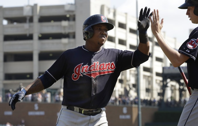 Cleveland Indians' Jose Ramirez is greeted after his two-run home run during the sixth inning of a baseball game against the Detroit Tigers, Sunday, Sept. 3, in Detroit. (AP Photo/Carlos Osorio)
