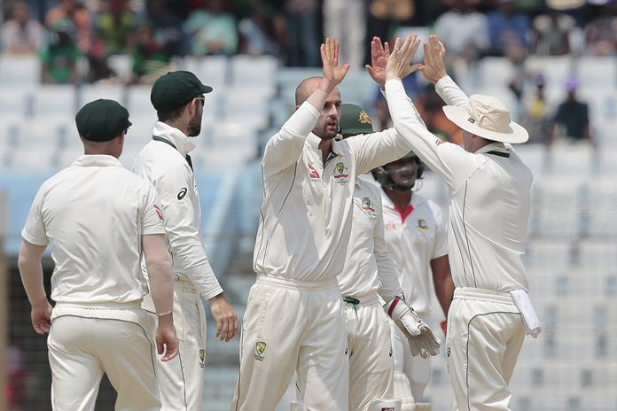 Australia's Nathan Lyon, center, celebrates with his teammates after the dismissal of Bangladesh's Mominul Haque during the first day of the second test in Chittagong, Bangladesh, Monday, Sept. 4. (AP Photo/A.M. Ahad)
