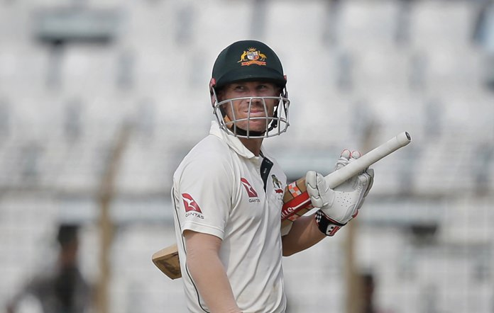 Australia's David Warner looks up as he walks back to the pavilion after his dismissal by Bangladesh's Mustafizur Rahman during the third day of their second test cricket match in Chittagong, Bangladesh, Wednesday, Sept. 6. (AP Photo/A.M. Ahad)