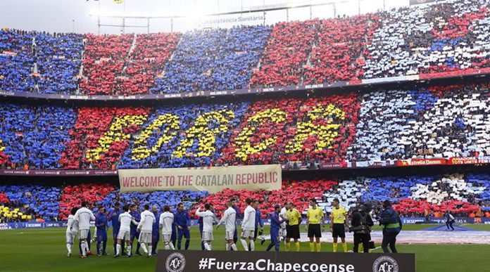 d0c7b7839 Players walk onto the field at the Camp Nou stadium in Barcelona prior to a  Spanish